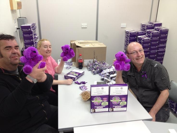 Our fantastic volunteers Tim, Jo & Phil packing Purple Day merchandise, LUV the Teddies