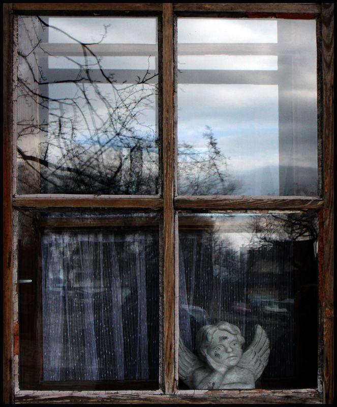 Window with an angel in Lanckorona, is a small village near Krakow, Malopolskie_ East Poland