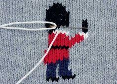 Мастер-класс по выполнению вышивки по петлям на вязаном изделии.
