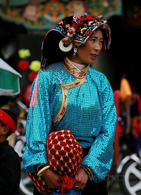 Woman from eastern Tibet in traditional clothes and headdress. Stock image from CTPS.com
