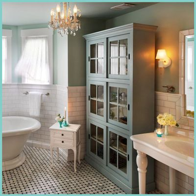 White and turquoise bathroom, retro tile flooring, turquoise cabinet