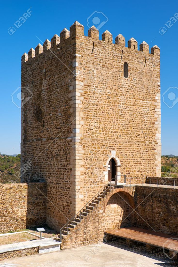 Keep tower of Mertola Castle with the adjoining fortress wall with battlements. Mertola. Portugal Stock Photo - 86660123