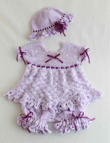 Little girls are fun to dress up in pretty pastel colors and ruffles. Crochet the Isabella Purple Dress Set Pattern for your little one and you will get just that. Your little one will look darling in this light and airy ensemble. The crochet design uses delicate shells to give each item in the ensemble a ruffly lace appearance. A coordinating ribbon and bows adorns each piece in the set to create a delicate look that is perfect for a baby.