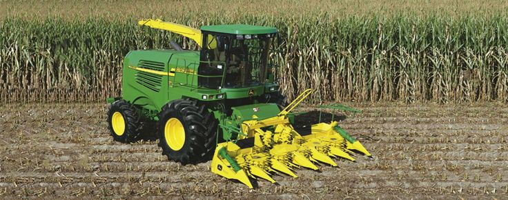 John Deere Harvester In Corn Field