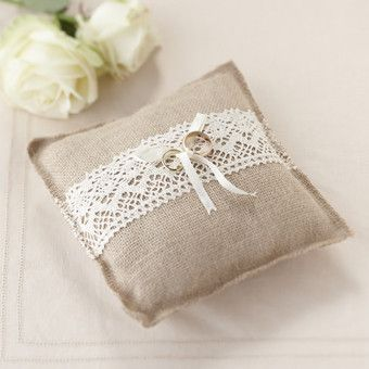 Our stunning hessian ring cushion with lace trim is the perfect addition for any  rustic wedding. The ring cushion measures 19cm(W) x 19cm(H) x 5cm(D).