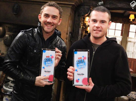 Danny Miller and Marc Silcock both receiving All About Soap Awards