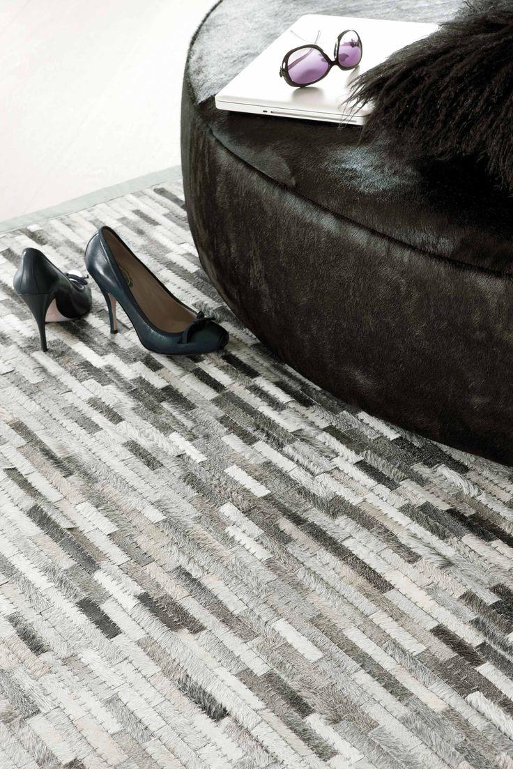 Feel Cowhide Carpet  http://heavenrugs.com/carpet/feel_cowhide-cowhide-170x240-rectangle-190_001_900