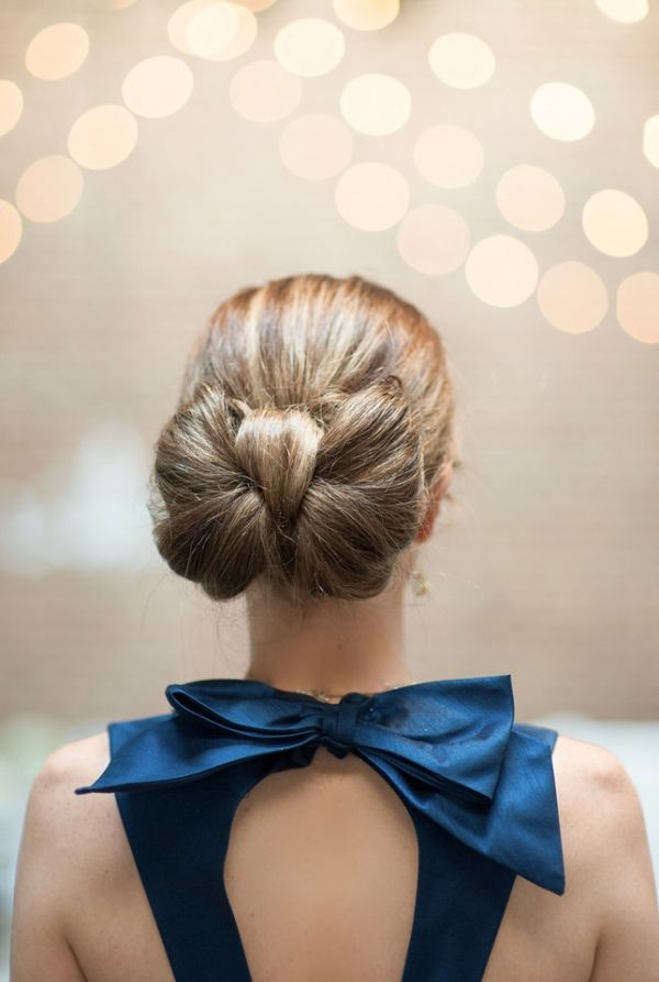 Wedding hair ideas: Bow bun by Yessie Makeup Artistry. Bow back dress by Alfred Sung.