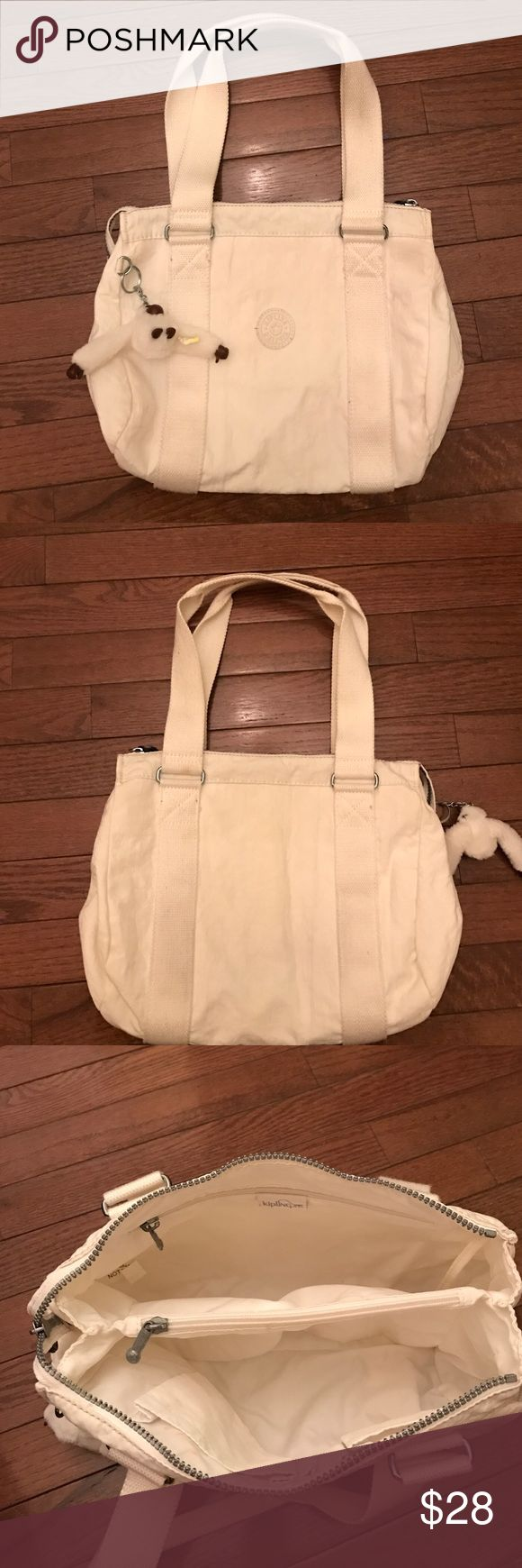 Kipling white handbag Gently used white Kipling handbag with slightly lipstick mark kissed inside of packet in the bag. Otherwise, no rip, stains, never been abused. been washed before this bag come out for sale. Kipling Bags Shoulder Bags