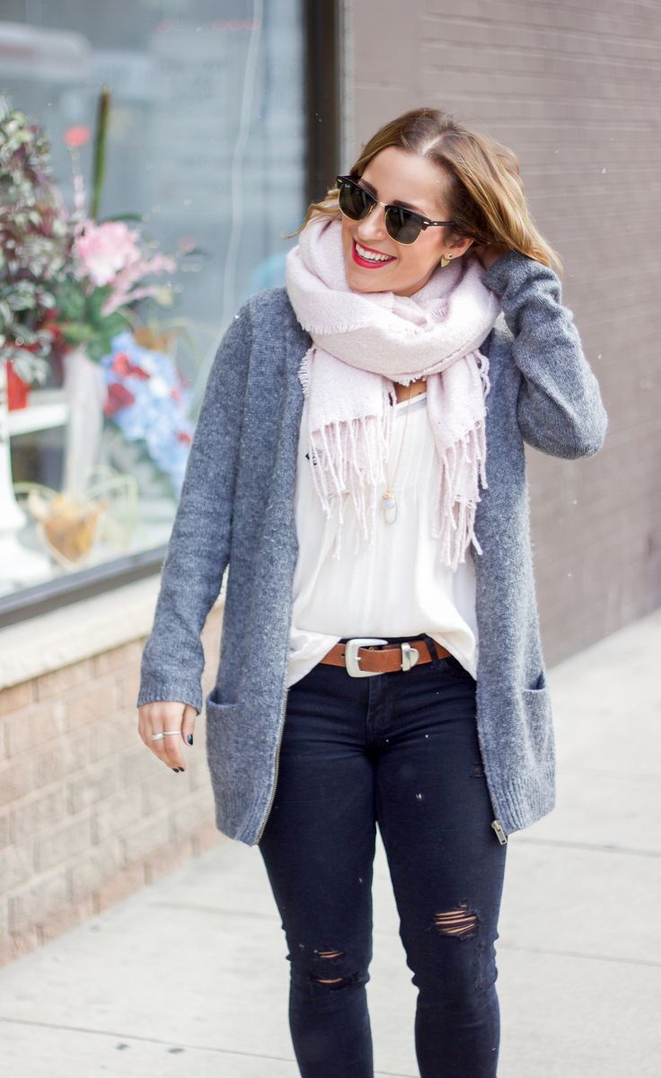 Canadian fashion blogger is wearing a simple winter outfit, featuring a pink scarf from Indigo and a grey cardigan from Old Navy