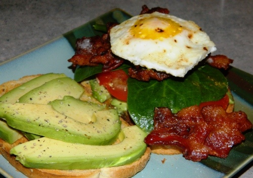 LOOK at this!!  avocado, bacon, spinach and egg as a sandwich!