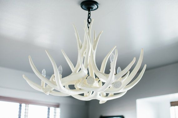Antler Chandelier D6 Faux Antler Chandelier by TheShabbyAntler.  This one is $359 and 36 in. wide.  Has 6 bulbs instead of 4.  Might prefer this one.