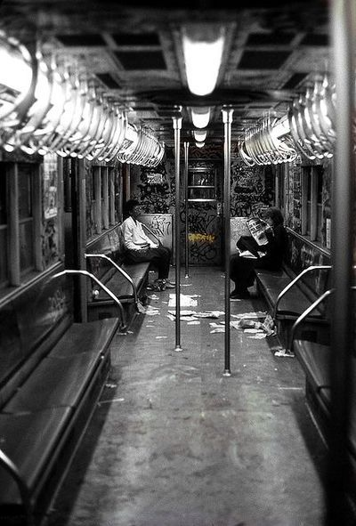 Old NYC subway car - graffitti, trash on the floor - the usual sight in the 1970s & 1980s.