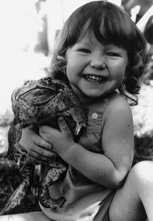 I love this pic of a girl and her toad...because i had a toad, too...but mine was a little old Pennsylvania toad not nearly this big!  Made me smile, too!