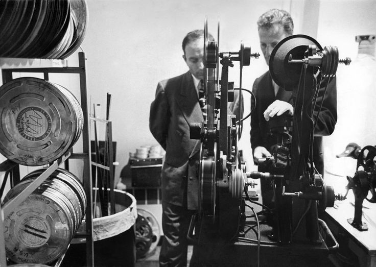 """Nov. 12, 1952: Robert A. Webb, right, and Boris D. Kaplan, film editors, checked a print of a short film called """"Christmas Toys"""" set to air on """"Omnibus,"""" an experimental TV program meant to """"elevate TV's level of taste, yet attract a mass audience,"""" according to the text with a picture essay, """"The Show Behind the TV Show."""""""