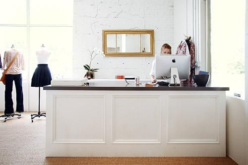 check out counter, dark wood or brick face instead of white?