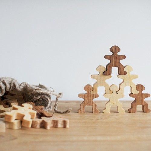 "Handmade in the USA from reclaimed hardwoods and finished with hand-rubbed mineral oil to bring out the natural beauty of the wood.     Ages 3 and up    Each puzzle person is 2"" tall    Elm, ash and walnut"