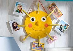 DIY Sunshine Photo Holder - Display your favorite vacation memories with this cheery sunshine photo holder. | #kids #craft