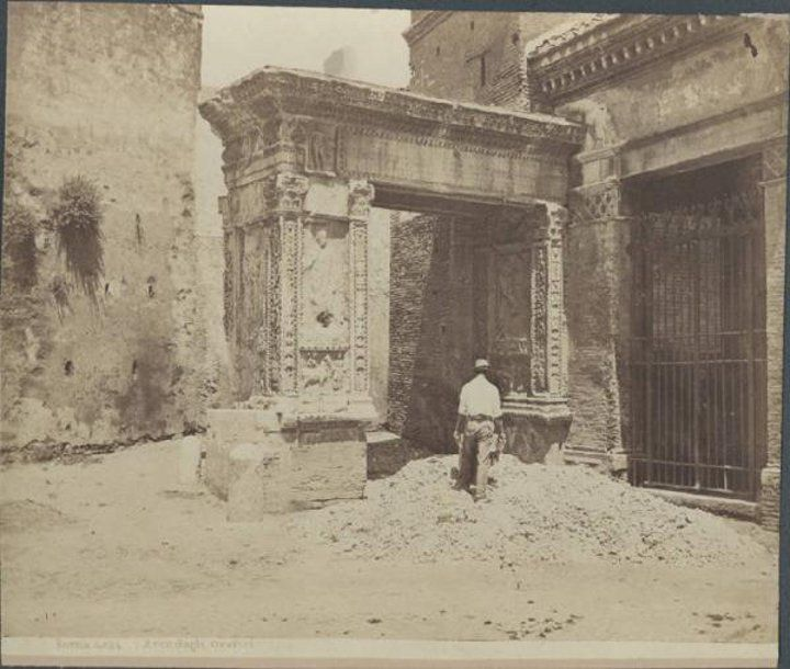 Arco Argentariorum 1885 located next to St. George in Velabro, behind the Arch of Janus