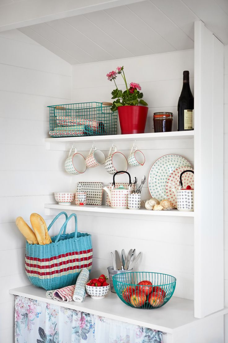 Carolyn Donnelly's eclectic SS14 homewares range features stencil plates, mugs and and teapots along with a wire fruit bowl, striped storage bag and colourful placemats