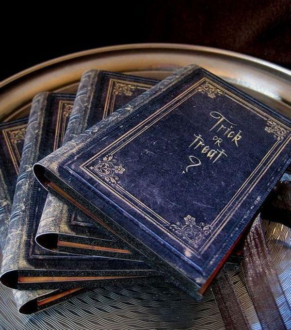 Halloween Wedding Invitations like books- too bad we're not having a Halloween wedding...