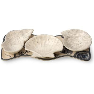 Serve guests in style with this shell-inspired tray. | $25