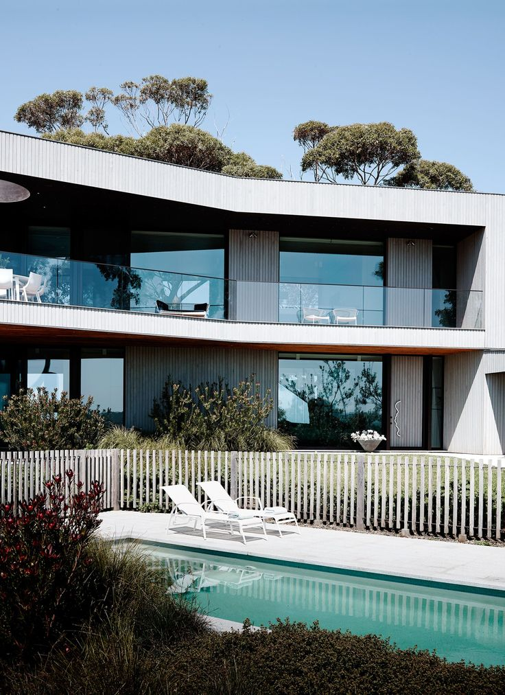 """""""The benign northern orientation has views over paddocks defined by rows of pine windbreaks with rolling hills in the foreground. The facade is clad in tailored narrow blackbutt timber boards and reads as an angular but warm and welcoming timber house,"""" says architect Reno Rizzo of [Inarc](http://www.inarc.com.au/)."""