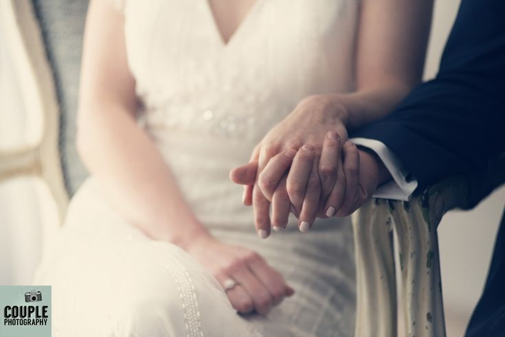 The bride & groom hold hands during their ceremony. Weddings at Conyngham Arms Hotel, Slane, by Couple Photography.