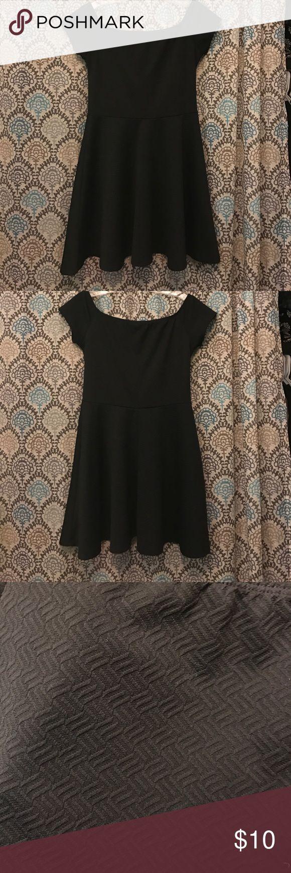Black skater dress Stretchy tight but flowy skater dress, goes slightly off the shoulder. Don't remember wear I bought it lol Dresses Mini