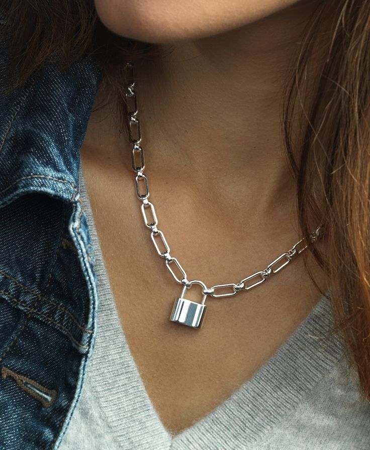 This edgy sterling silver necklace has a working padlock that functions as the clasp. Wear it layered or on its own!