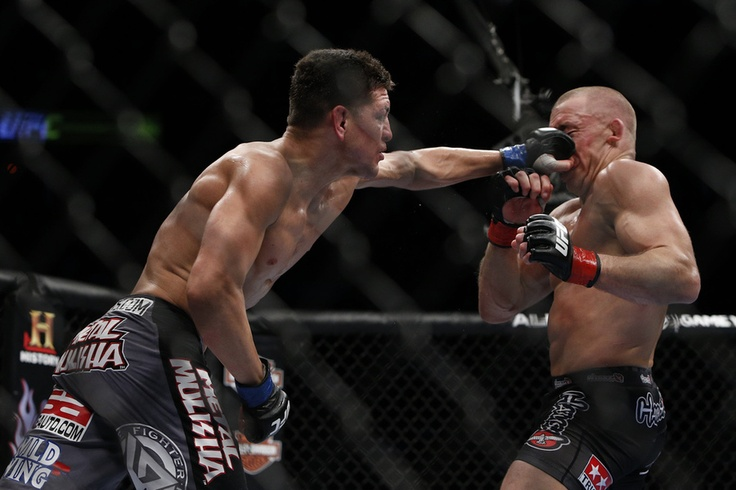 GSP getting punched in the face by nick Diaz UFC 158 photos - MMA Fighting