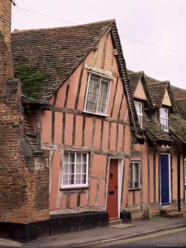 Pink Tudor period timbered House in Lavenham, Suffolk, England  There was a crooked house on a crooked little street, it went a crooked mile.