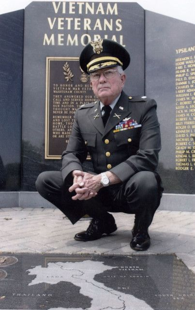 Retired U.S. Army Lt. Col. Charles Kettles poses in front of the Vietnam Veteran's Memorial in Ypsilanti Township, Michigan, 2009. (Photo courtesy of Retired U.S. Army Lt. Col. Charles Kettles)