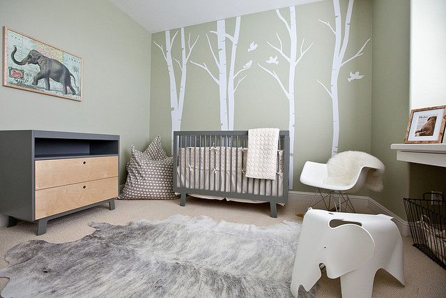This thoroughly modern space gets a hit of baby softness with the addition of lovely birch tree wall decals.