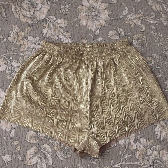 H&M Gold Shorts H&M Gold shorts. Size 2. NO trades. Feel free too offer ! H&M Shorts