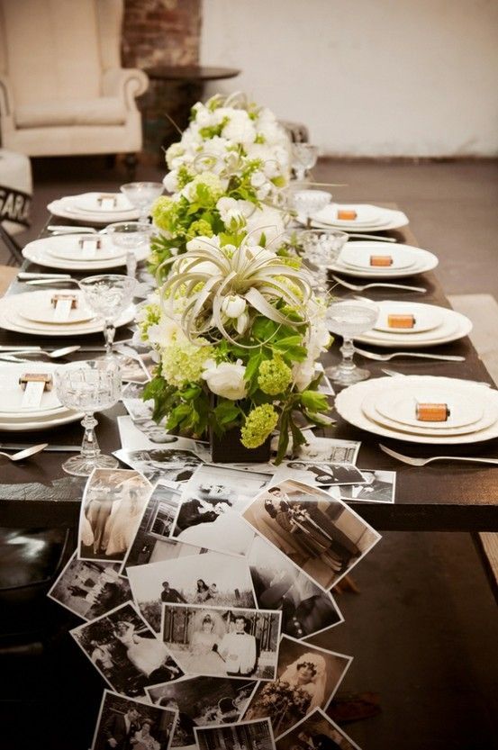 A table runner made out of laminated copies of family photos. Perfect for a wedding or family get-together! (Trendy Pics)