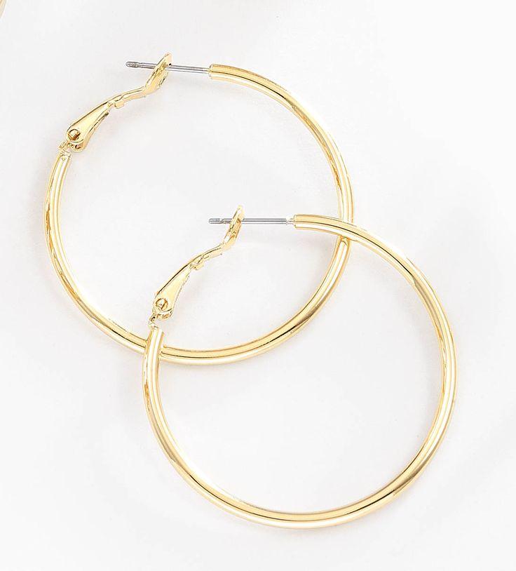 Arracadas circulares delgadas y grandes elaboradas con 4 baños de oro de 18 kt y sujeción de poste con clip. Modelo 415398L.