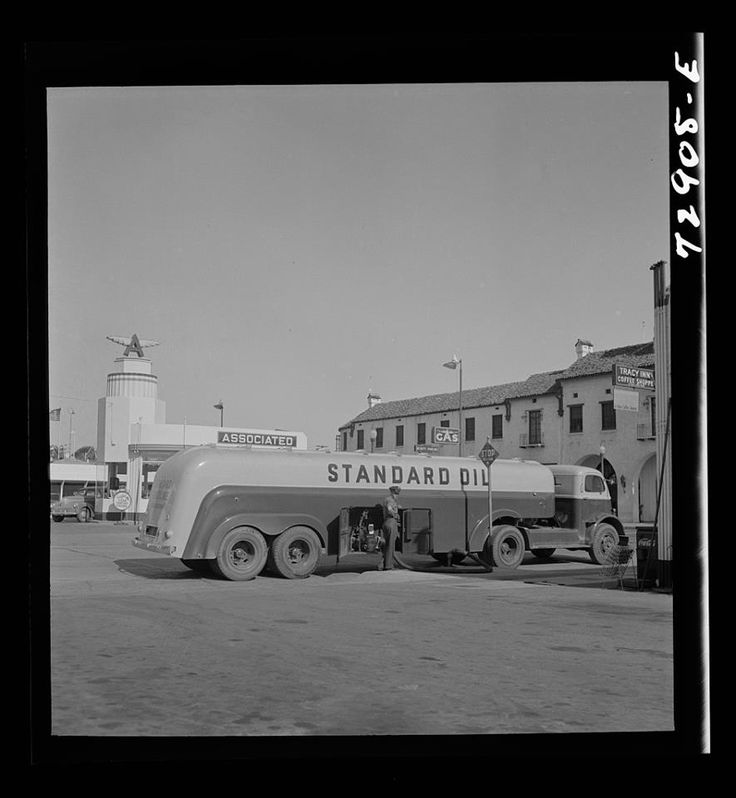 1942 Tracy, California. A gasoline tank truck delivering gasoline to a filling station. Taken by Russell Lee
