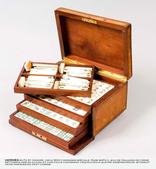 Hermès Chinese Mahjong Set c.1930's. made from mahogany tree and fawn-coloured leather, bone and ivory.