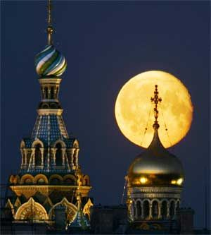 A full moon rises above The Church of the Savior on Spilled Blood (also known as the Cathedral of the Resurrection of Christ) in St. Petersburg, Russia, June 14, 2006. [© AP Images]