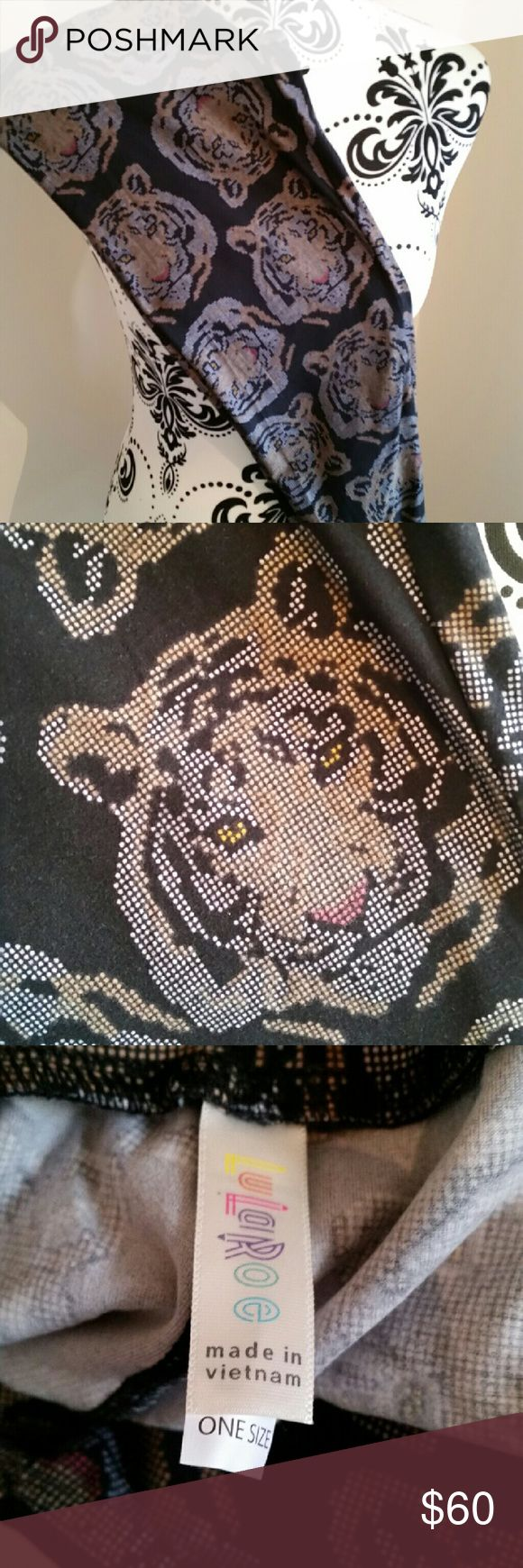 BNWT LOLAROE OS LION/TIGER LEGGINGS HTF Brand new new worn lularoe leggings OS ONE SIZE-  0-10 . BLACK BACKGROUND BEAUTIFUL BUTTERY SOFT. Awesome leggings. You will not be disappointed.  Check out my eBay reviews- purrdy3us Lularoe brand new with tag. Made in China.  I'm not a consultant I'm just someone that loves to hunt down all the HTF prints. It takes a lot of source, photograh, list and shipping these goodies. Supply and demand = price. LuLaRoe Pants Leggings