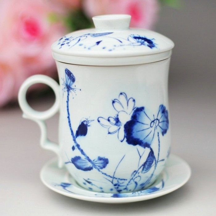 white and blue ceramic cup