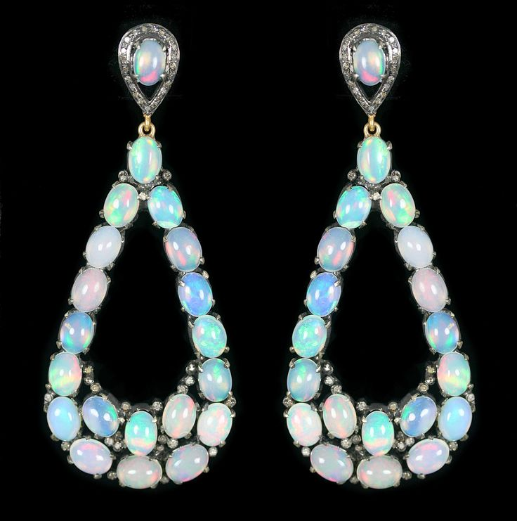Opal & Diamond Earrings, accompanied by 28.80 carats of Opal and 0.72 carats of Diamonds. Set in 14 karat Yellow Gold & Silver.