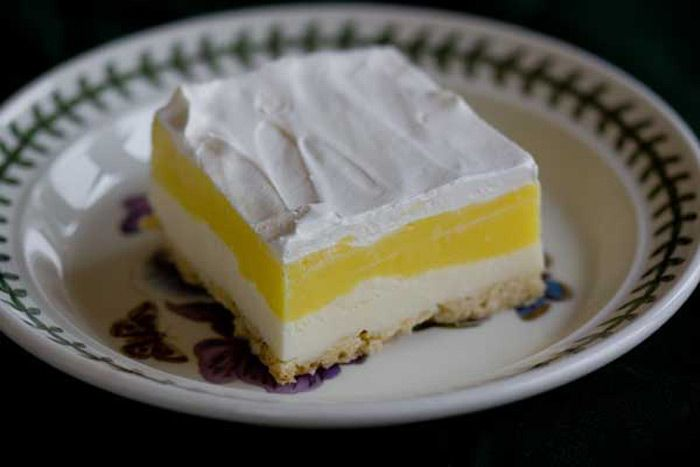 A family friend shared this lemon and cream cheese dessert with me. It has been a hit with our family now for all our get togethers.              Ingredients:          1 stick butter – melted  1 cup flour  1 1/2 cup pecans