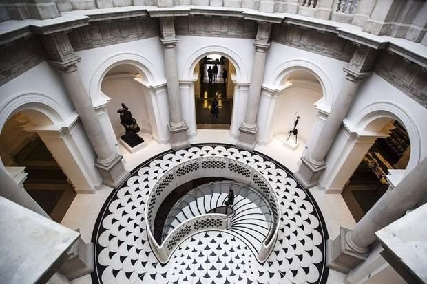 The spiral staircase in the refurbished entrance to Tate Britain A note secreted behind the walls of the Tate in the 19th century by a gang of plasterers has gone on display at Tate Britain to mark its £45million refit.