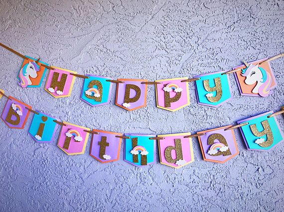 This listing is for a very cute Unicorn/Majestic themed Happy Birthday Banner. With rainbows and clouds on every letter. -Clouds are made with white glitter cardstock. Dimensions: Each pennant is 5.5- not a small banner. Hung in two pieces approximately 6 & 8 feet long with gold