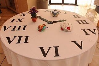 Clock Table - a food or something at each hour. Put placecard if the food item can't sit without refrig.