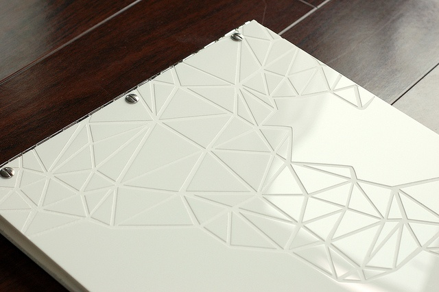 Custom white acrylic portfolio with engraving and cut-out treatment Flickr