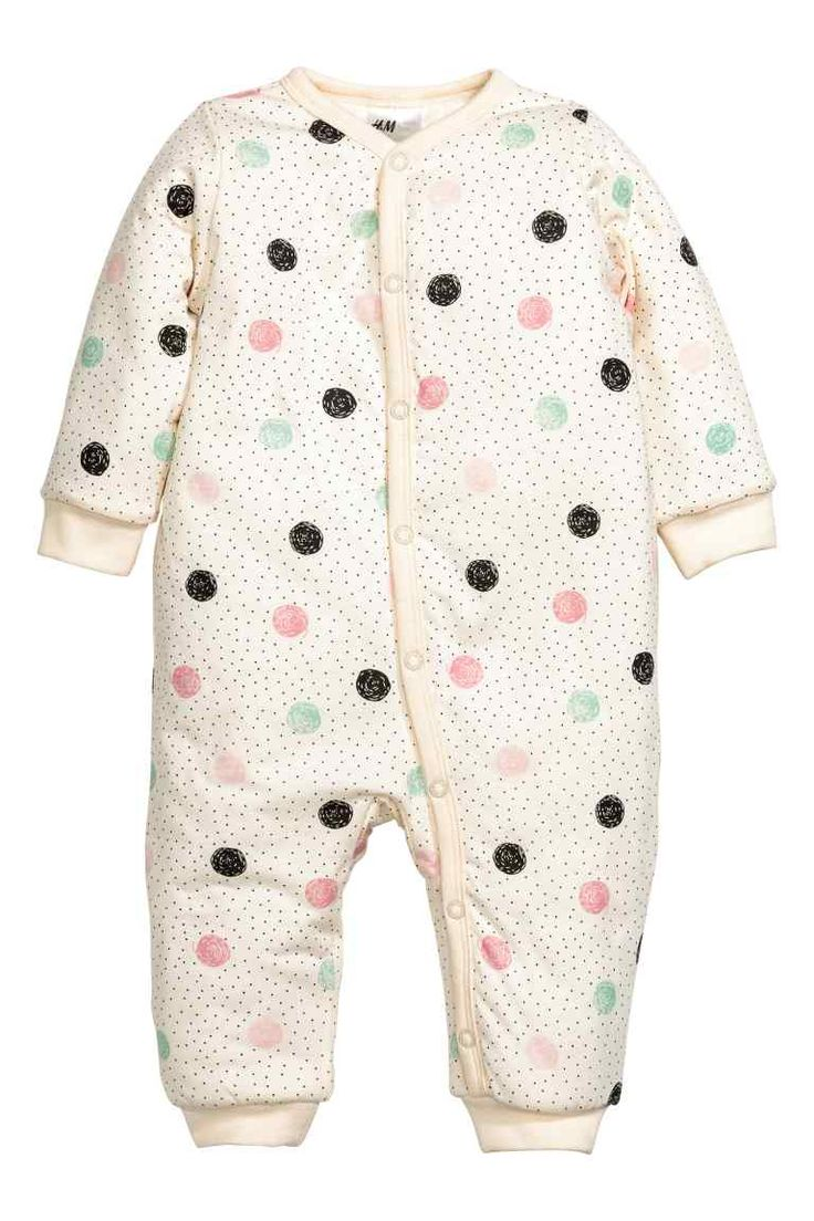 Padded pyjama suit: Lightly padded pyjama all-in-one suit in soft organic cotton jersey with press-studs down the front and along one leg, and ribbing at the cuffs and hem. Polyester padding.