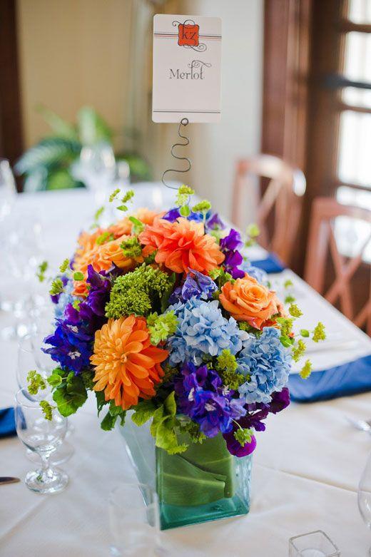 Centerpiece bluplerum viburnum orange dahlias blue